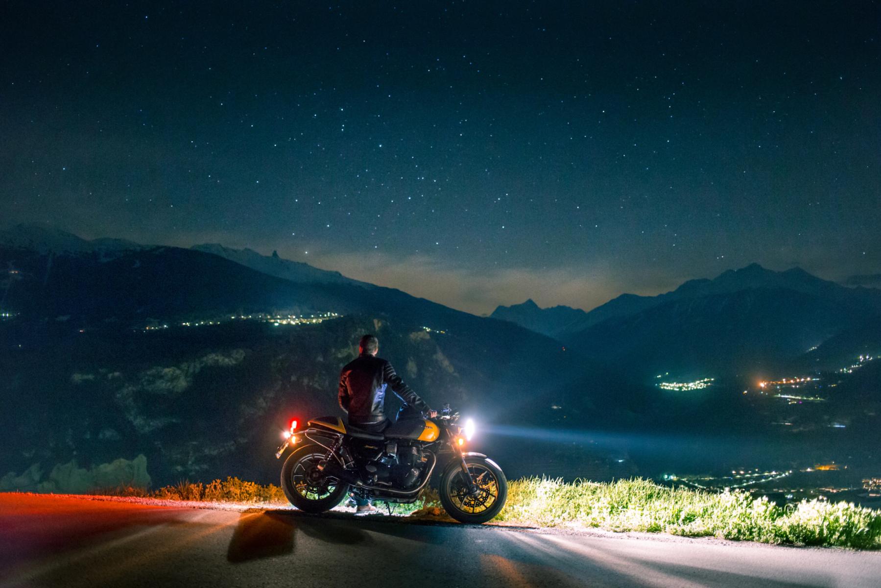 motorcycle under starry nightsky